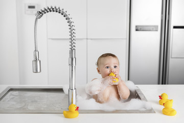 kitchen sink with a baby taking a bath